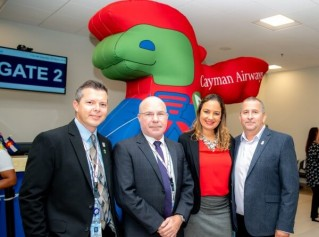 Ribbon Cutting celebration for the inaugural flight from Grand Cayman to Denver
